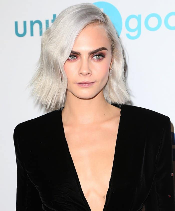 Edgy makeup and hair finish this standout look