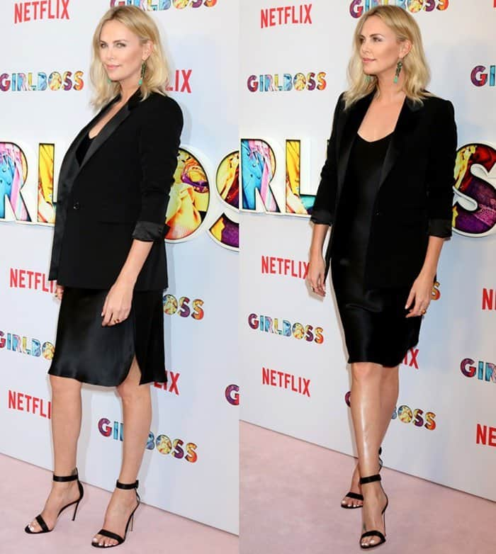 Charlize poses for the photographers in a black-on-black ensemble