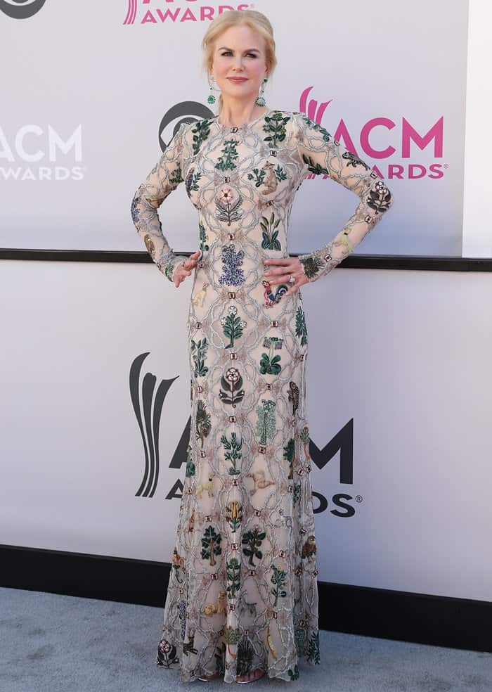 Nicole Kidman posing for the photographers in an embroidered Alexander McQueen frock