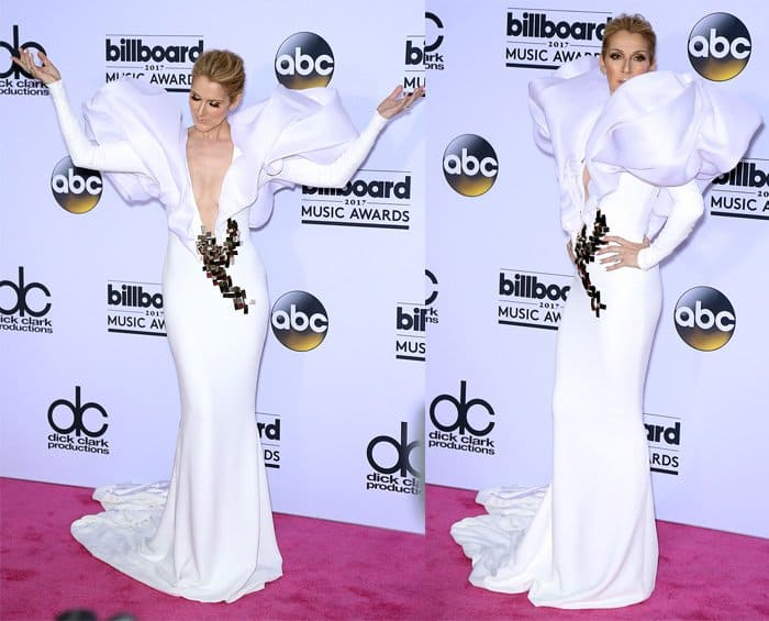 Celline Dion makes a dramatic entrance in white plunging neckline gown with wings
