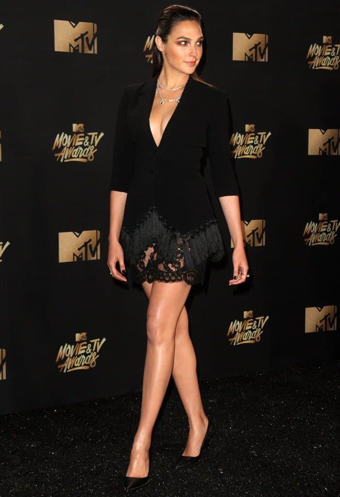Gal Gadot wearing a Cinq à Sept tuxedo dress that showcased her long legs