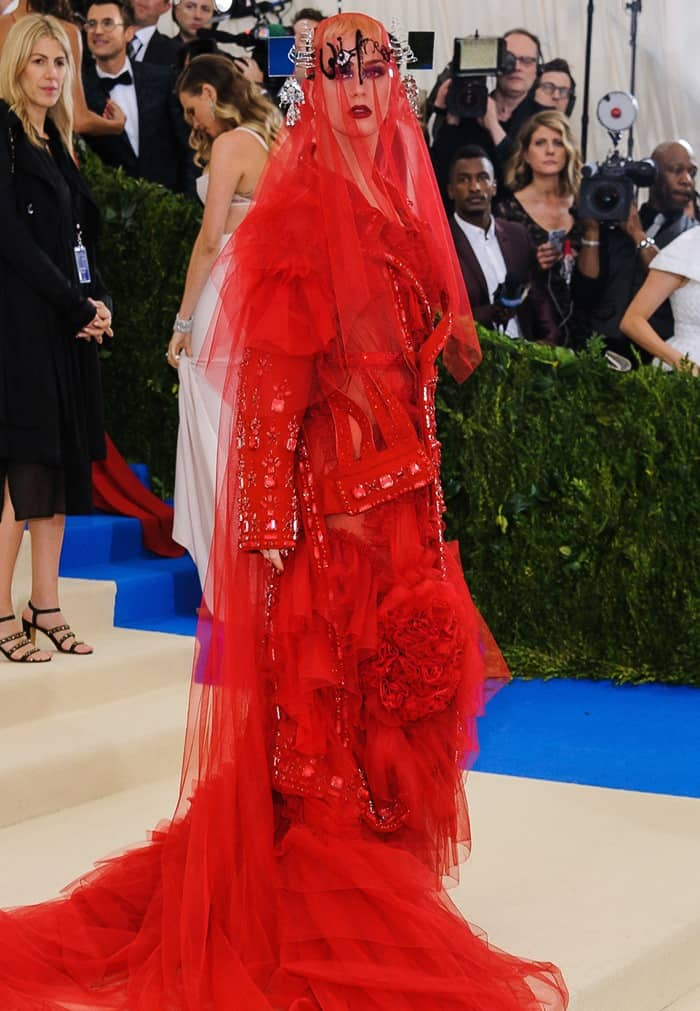 Katy Perry wearing a fiery-red Maison Margiela Spring 2017 Couture dress at the 2017 Metropolitan Costume Institute Benefit Gala held at the Metropolitan Museum of Art in New York City, on May 1, 2017