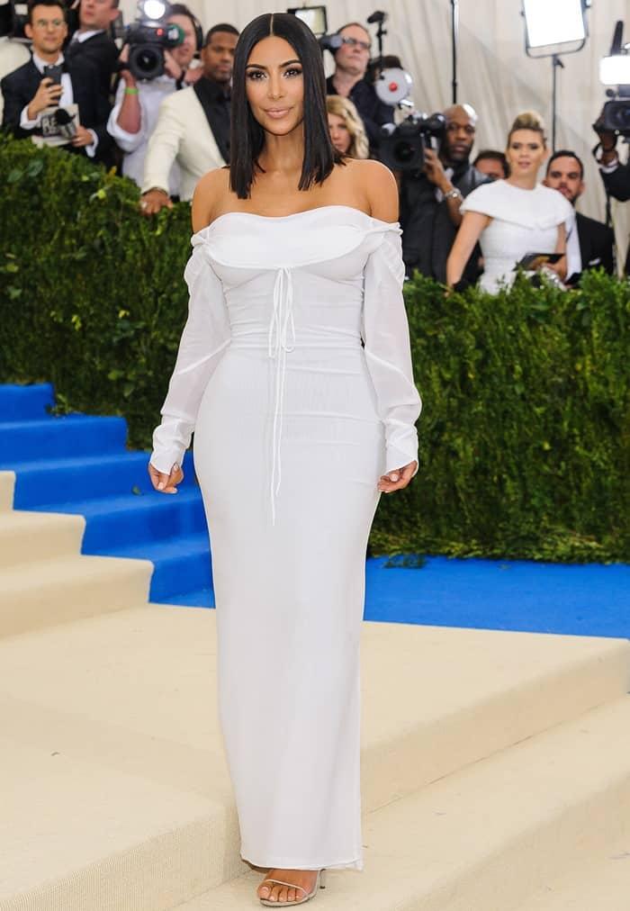 Kim Kardashian wearing a plain white Vivienne Westwood dress at the 2017 Metropolitan Costume Institute Benefit Gala held at the Metropolitan Museum of Art in New York City, on May 1, 2017