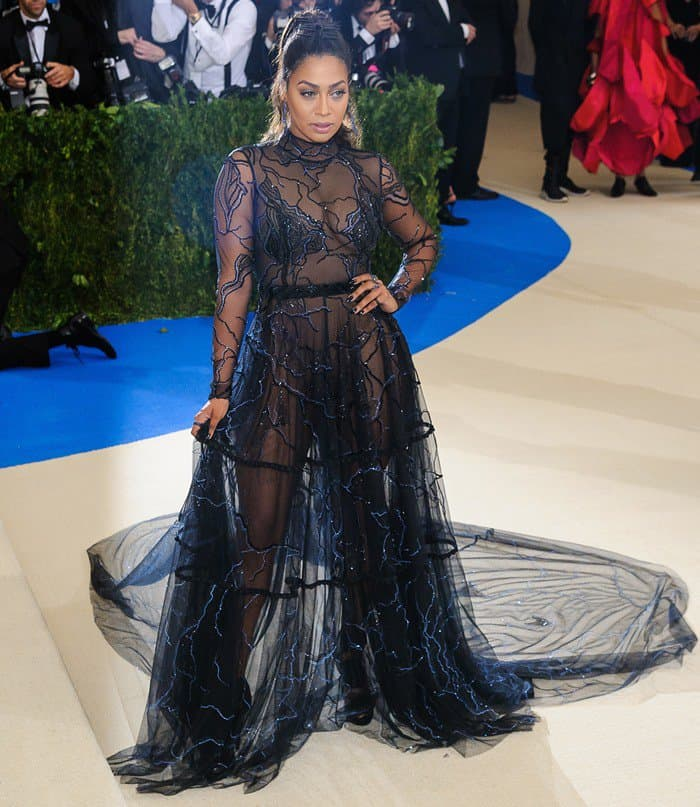 La La Anthony's gownfeaturing black diamond jewelry and small sheer train