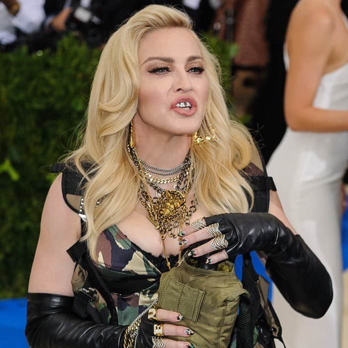 Madonna wearing a full length camouflage Moschino gown at the 2017 Met Gala in New York City on May 1, 2017