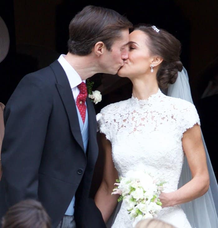 The newly weds share a kiss after the wedding ceremony