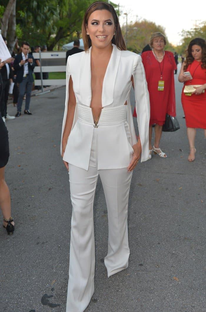 Eva Longoria wearing a white Elisabetta Franchi jumpsuit at the 2017 Billboard Latin Music Awards