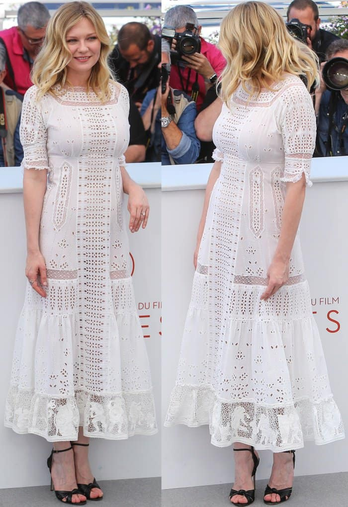 "Kirsten Dunst wearing a white Loewe spring 2017 dress and Gucci ankle-strap sandals at ""The Beguiled"" photocall during the 70th annual Cannes Film Festival"