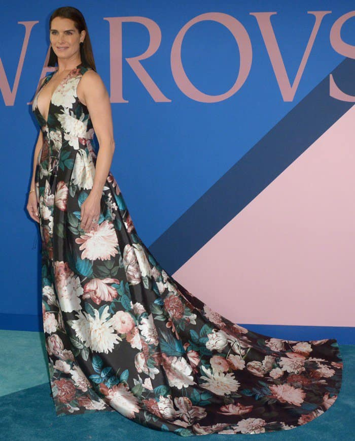 We love the dramatic long train of this floral gown!
