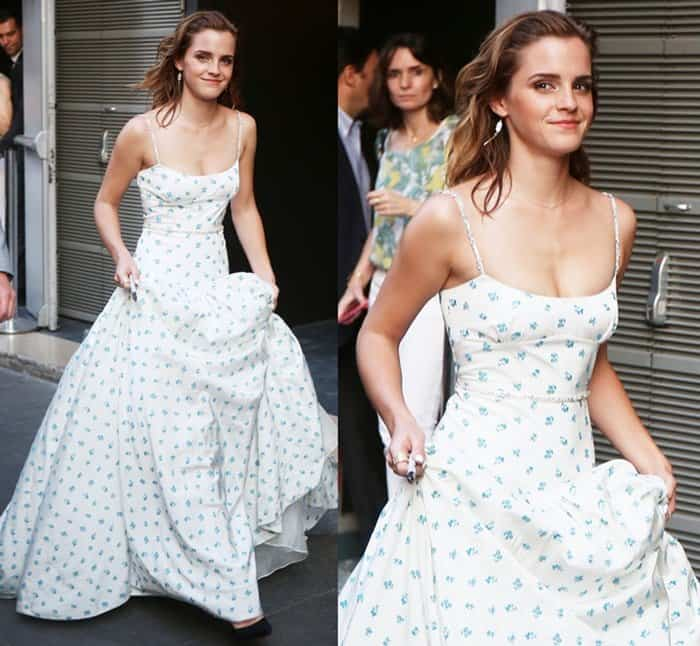 Emma Watson made sure she avoided dirt on her gown's hemline by carrying her skirt.
