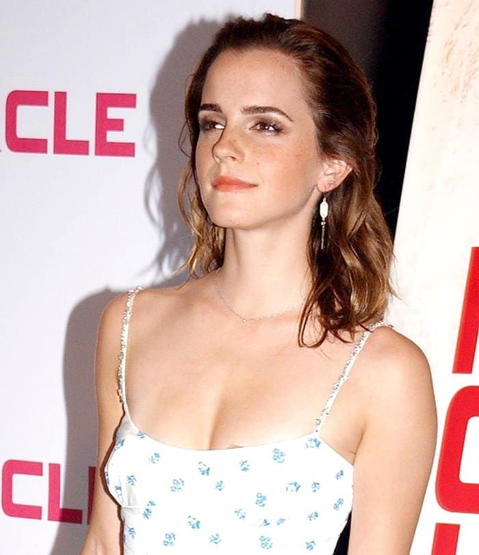 Emma Watson kept her hair loose and wavy for a modern look.