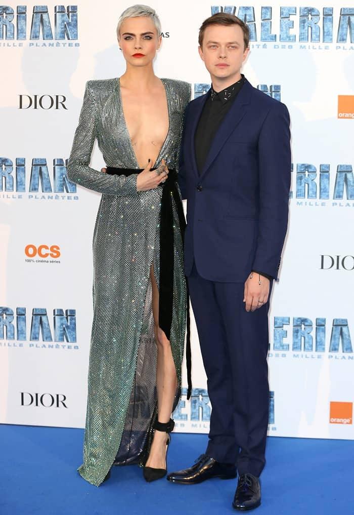 Cara Delevinge attends Paris premiere of Valerian with co-star Dane DeHaan.