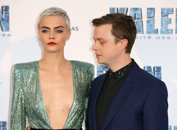 Dane DeHaan snapped taking a quick look at Cara Delevingne's chest.