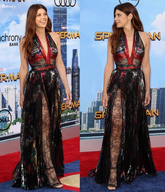 Marisa Tomei put on a leggy display at the LA premiere of Spiderman: Homecoming.