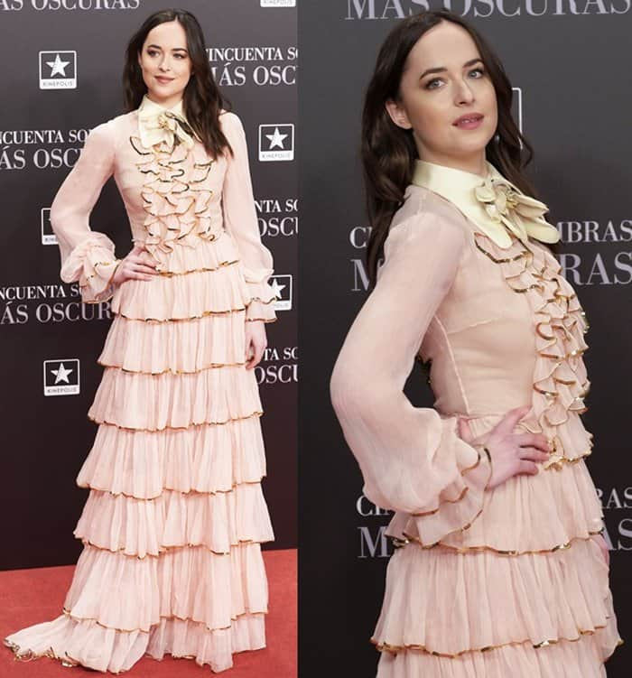 "Dakota Johnson wearing a dramatic tiered dress at the Madrid premiere of ""Fifty Shades Darker""."