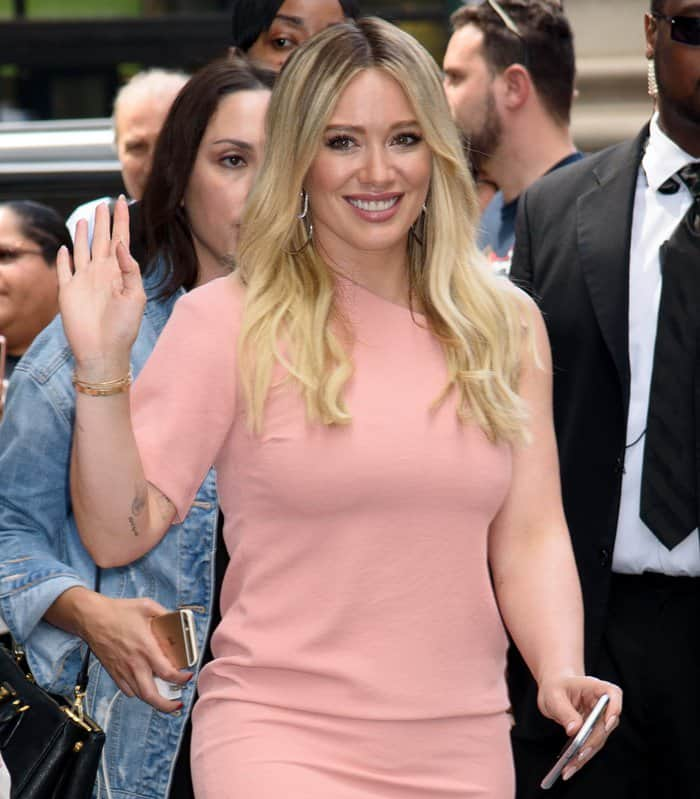 Hilary Duff wearing a pretty blush-toned pink dress in New York.