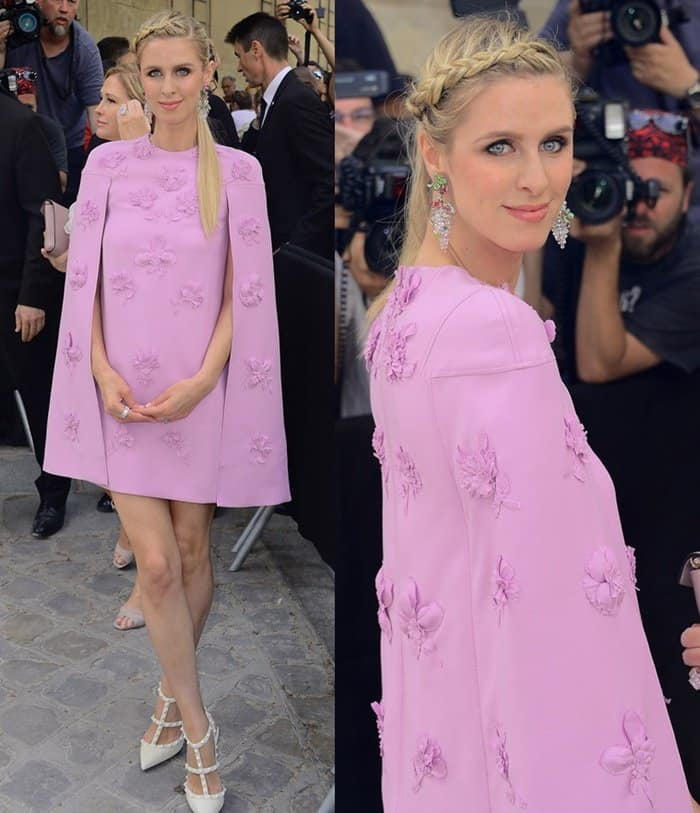 Nicky Hilton wearing a caped pink dress at the Valentino show at Paris Fashion Week.