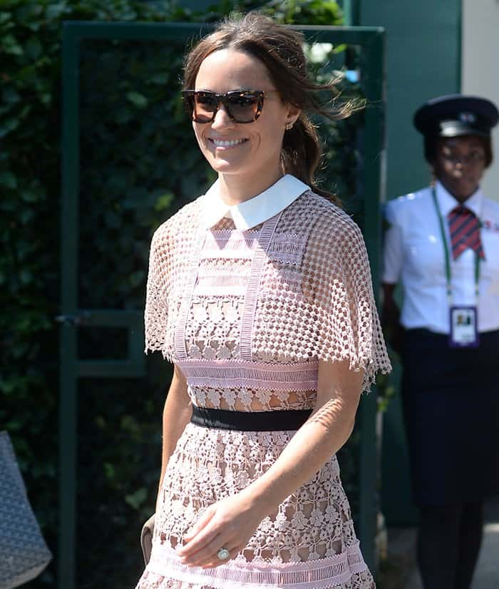 Pippa Middleton paired her sheer lace dress with oversized cat eye sunglasses.