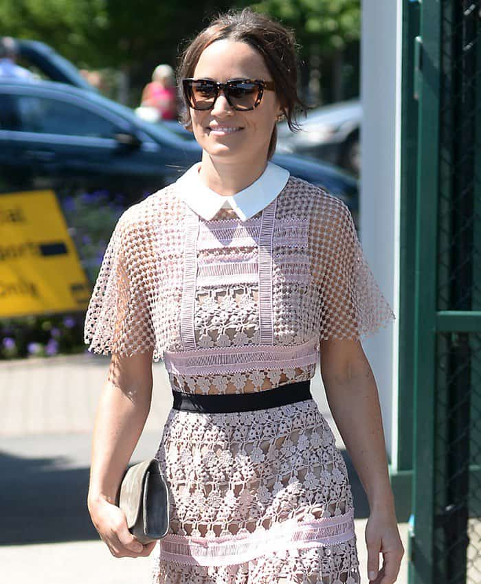 Pippa Middleton carrying a gray clutch with her sheer lace dress at Wimbledon.