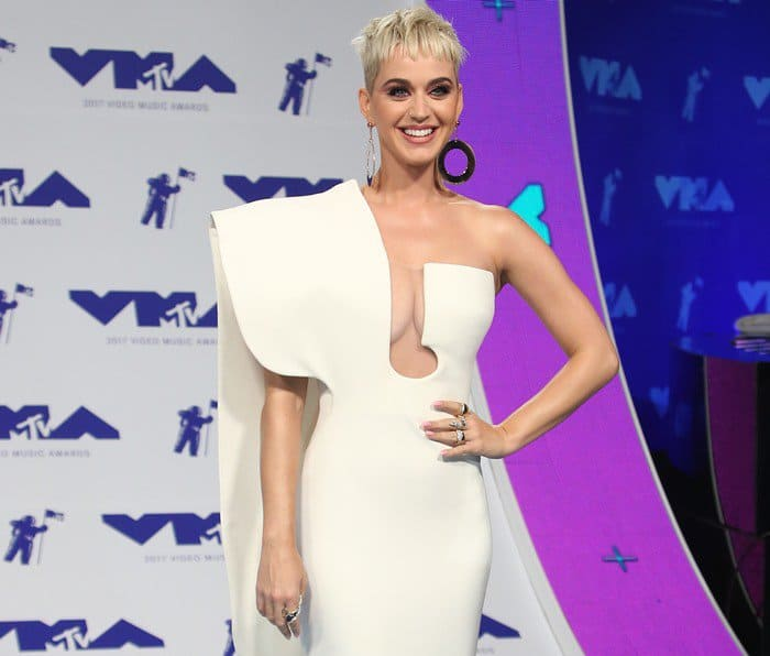 Katy Perry wearing a white one-shoulder Stéphane Rolland dress with cutout detailing at the 2017 MTV Video Music Awards held at The Forum in Inglewood, California, on August 27, 2017