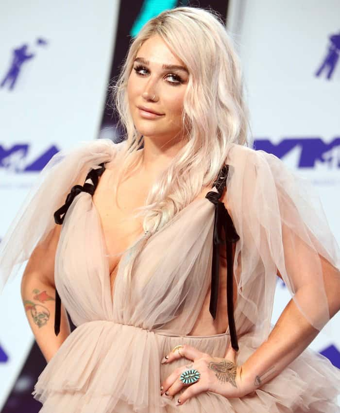 Singer Kesha posing in a ball gown at the 2017 MTV VMAs.
