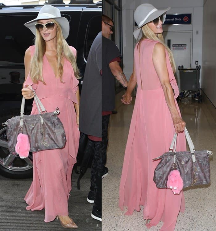 Paris Hilton spotted at LAX wearing a breezy pink dress.