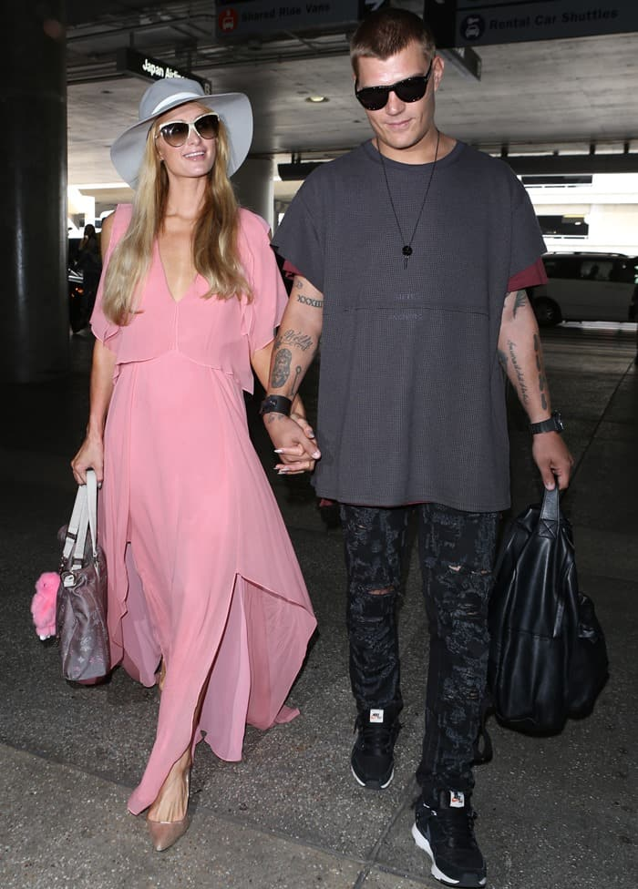 Paris Hilton with boyfriend Chris Zylka at LAX.