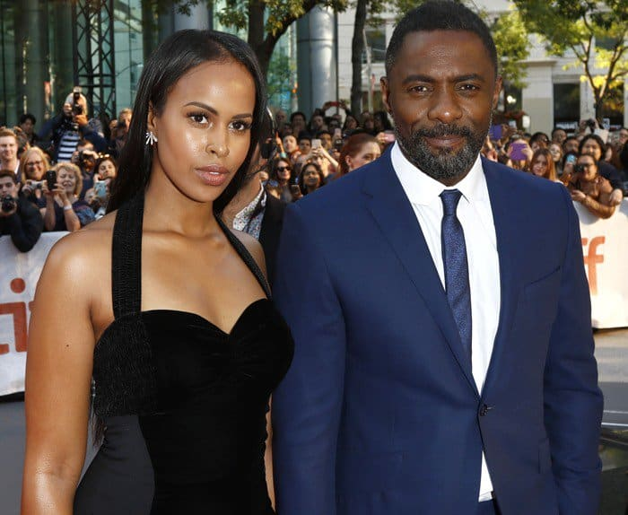 45-year-old English actor Idris Elba arriving with his 29-year-old girlfriend Sabrina Dhowre