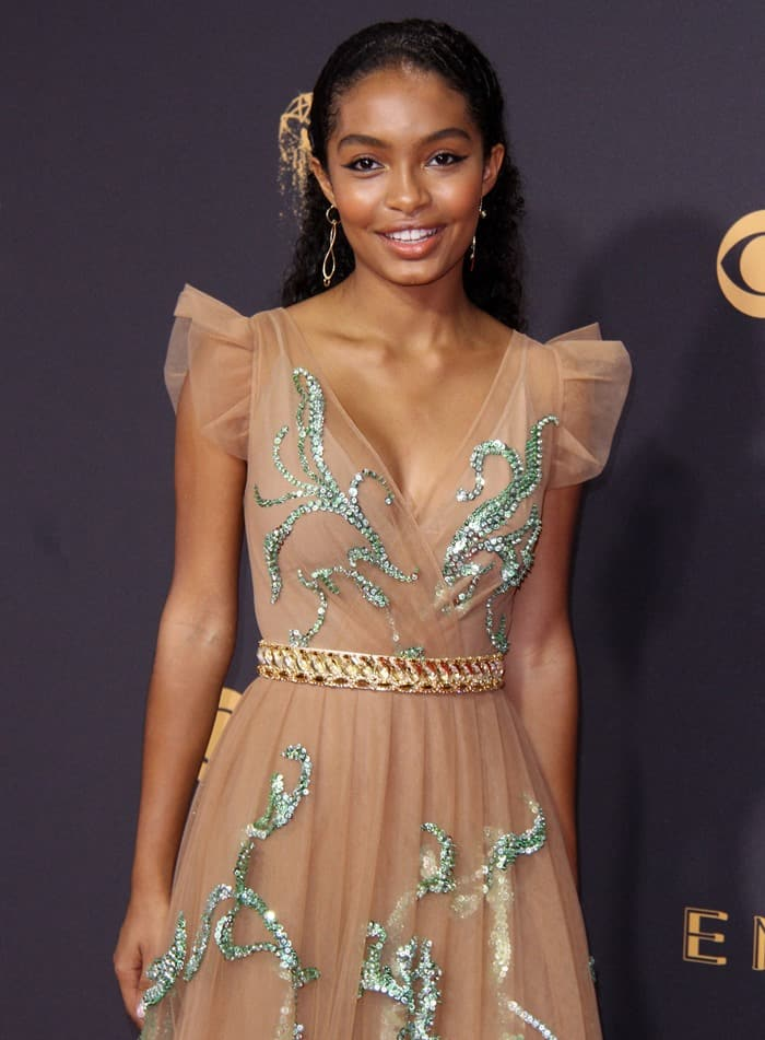Yara Sayeh Shahidi wearing an embellished beige Prada gown with ruffled shoulders at the 2017 Emmy Awards held at the Microsoft Theater in Los Angeles on September 17, 2017
