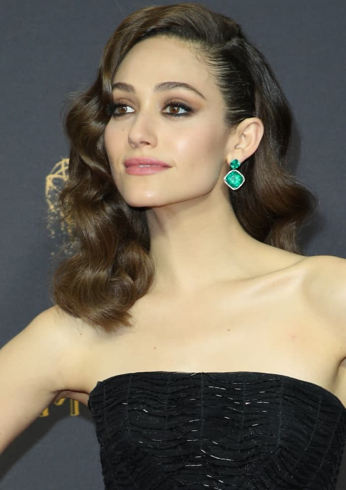 Emmy Rossum wearing a strapless black gown from Zac Posen and emerald jewels from Lorraine Schwartz at the 69th Emmy Awards