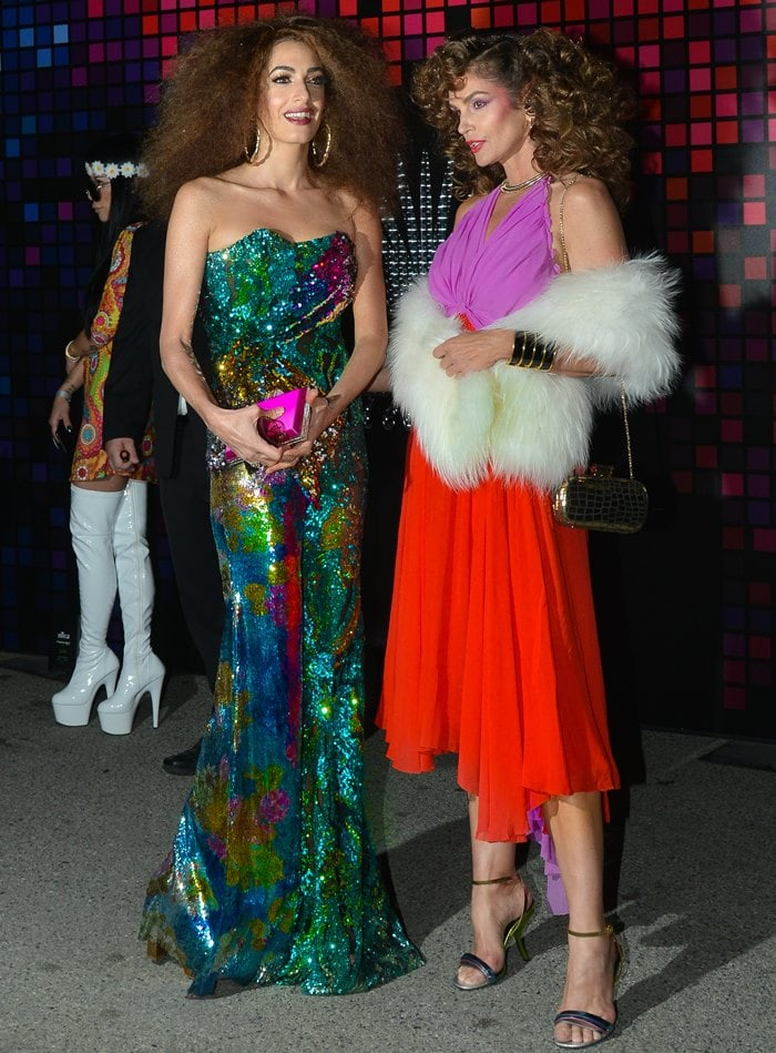 Amal Clooney and Cindy Crawford dress up as 70s disco babes for Halloween.