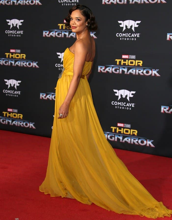 Tessa Thompson wearing a yellow gown at the premiere or Thor: Ragnarok.