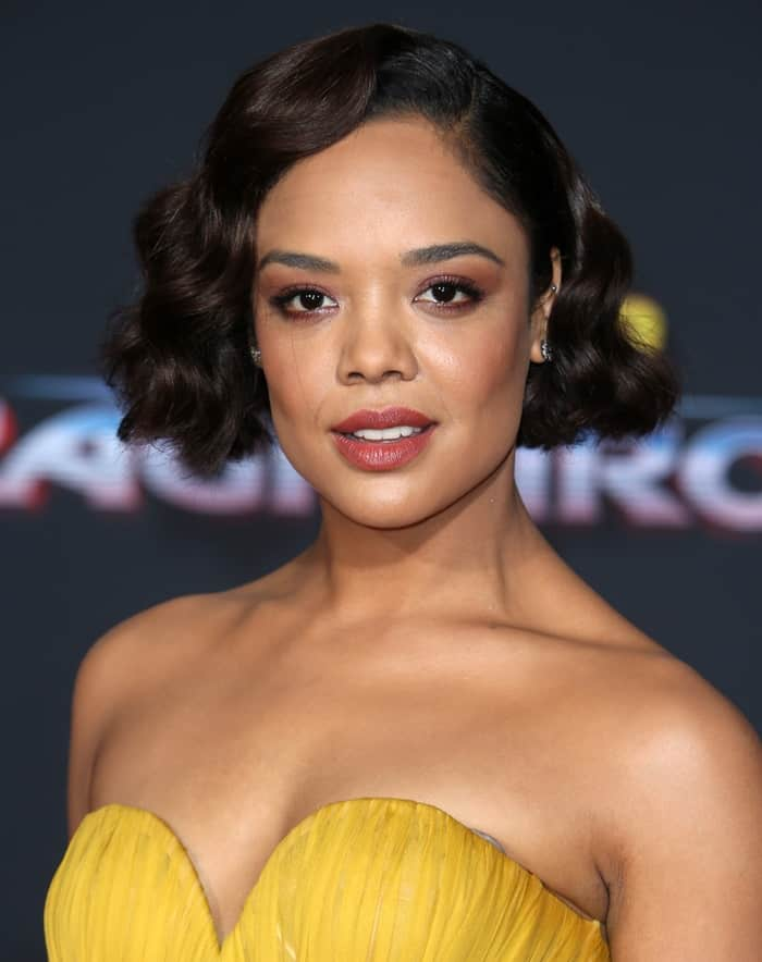 "Tessa Thompson attends the world premiere of 'Thor: Ragnarok"" in a yellow gown."