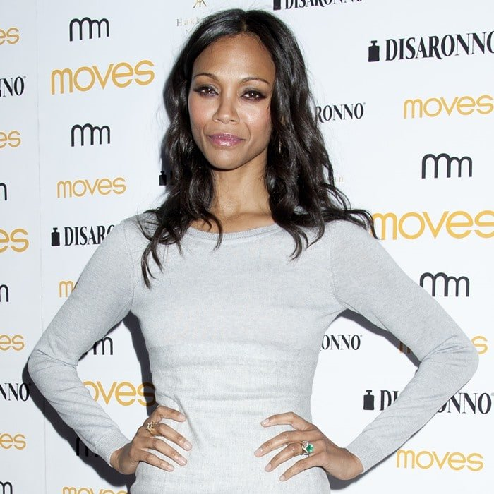 Zoe Saldana in a grey sweater dress from Michael Kors at the New York Moves Magazine cover party on May 7, 2014