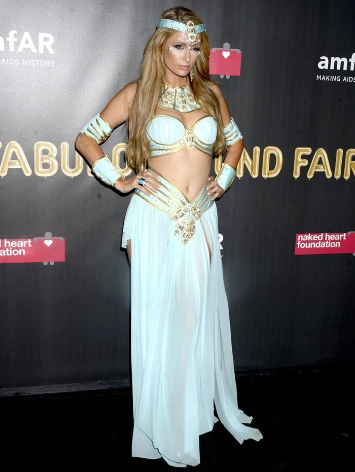 Paris Hilton wearing a costume at amfAR & The Naked Heart Foundation Fabulous Fund Fair.
