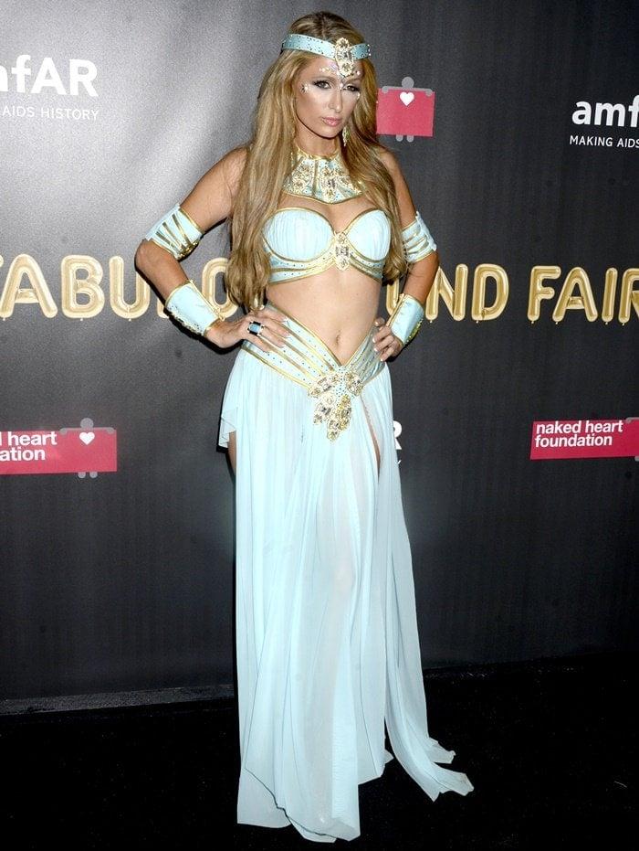 Paris Hilton wearing a costume at amfAR & The Naked Heart Foundation Fabulous Fund Fair.