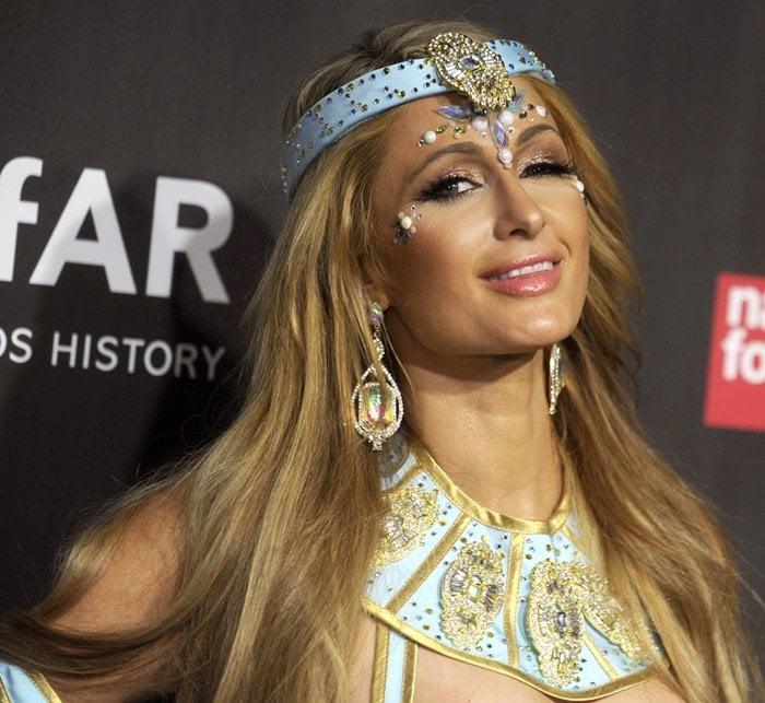 Paris Hilton in a costume at amfAR & The Naked Heart Foundation Fabulous Fund Fair.