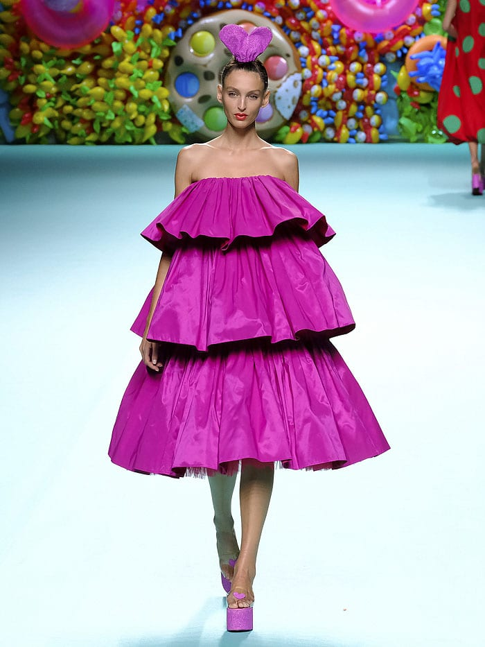The Agatha Ruiz de la Prada spring 2018 pink tiered dress as presented during Mercedes-Benz Fashion Week Madrid Spring/Summer 2018 in Madrid, Spain, on September 15, 2017.
