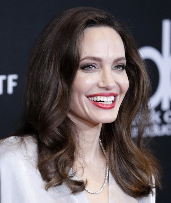 Angelina Jolie wearing a velvet-trimmed satin wrap dress by Jenny Packham at the 2017 Hollywood Film Awards at the Beverly Hilton Hotel in Beverly Hills, California, on November 5, 2017