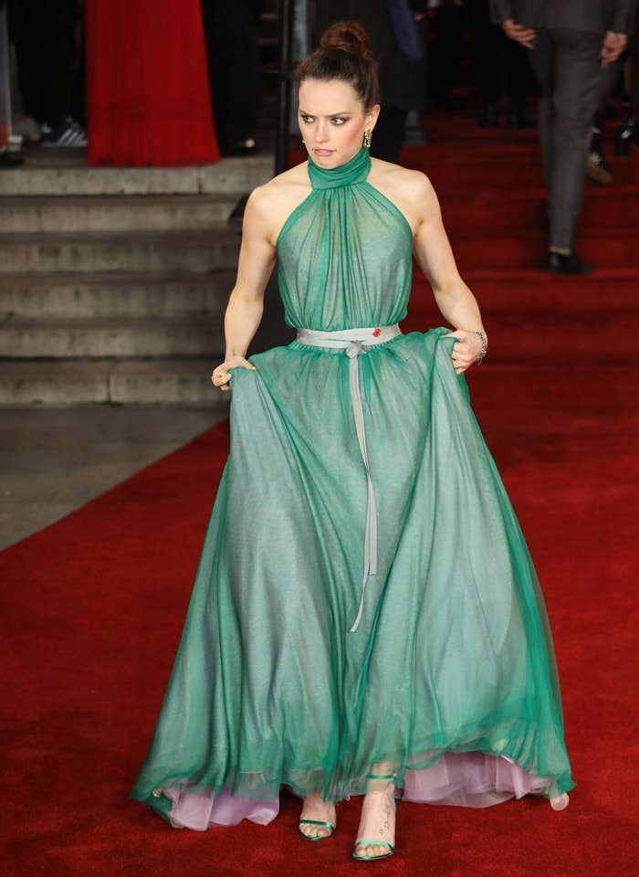 Daisy Ridley wearing a custom Vivienne Westwood halter gown at the world premiere of 'Murder On The Orient Express' held at the Royal Albert Hall in London on November 2, 2017