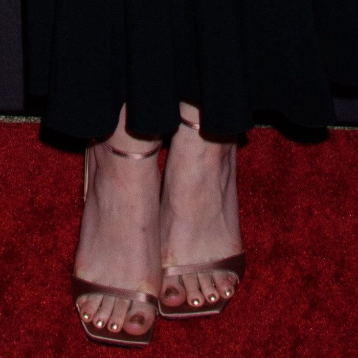 Dakota Fanning showing off her feet in sandals from Sergio Rossi