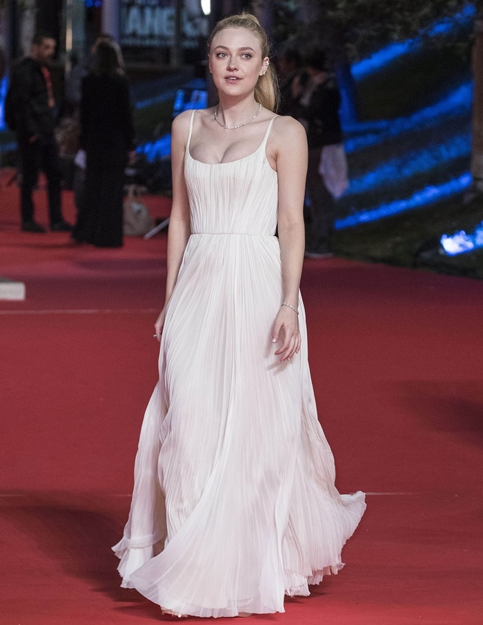 Dakota Fanning looks beautiful in a white gown at the premiere of her new film 'Please Stand By' at the 12th Rome Film Fest in Rome, Italy, on October 31, 2017