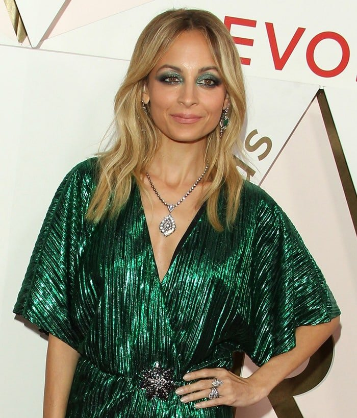 Nicole Richie wears metallic green dress at the 2017 Revolve Awards.