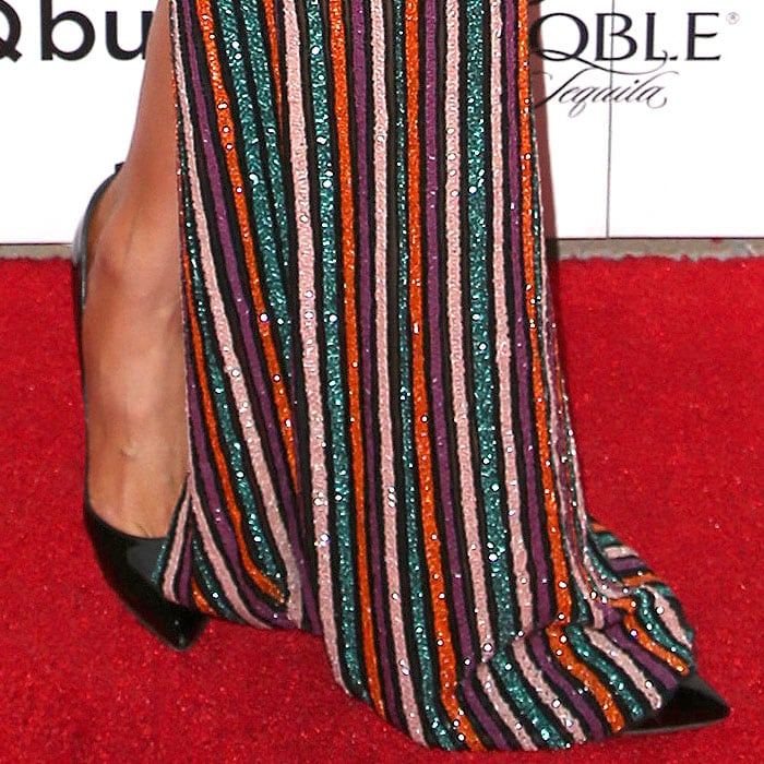 Closeup of Paris Hilton's Tom Ford patent pointy-toe pumps worn without the padlock ankle straps.