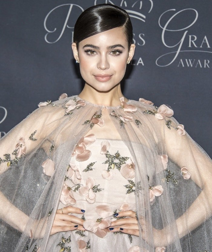Sofia Carson wearing a Monique Lhuillier nude tulle princess gown to the 2017 Princess Grace Awards Gala held at The Beverly Hilton Hotel in Beverly Hills, California, on October 25, 2017