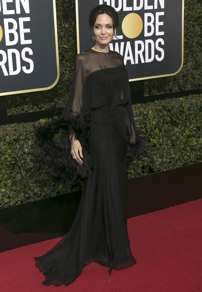 Angelina Jolie wearing a ruched chiffon Atelier Versace gown at the 2018 Golden Globe Awards held at the Beverly Hilton Hotel in Beverly Hills, California, on January 7, 2018