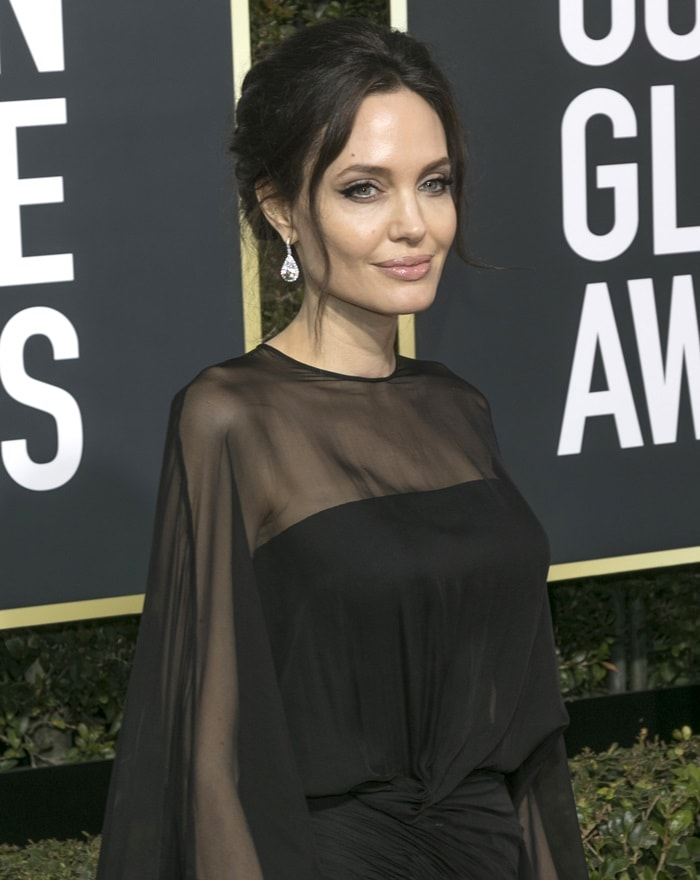 Angelina Jolie accessorized with diamond drop earrings by Forevermark