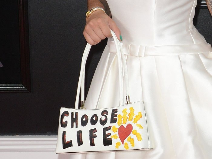 """Details of Joy Villa's statement-making white handbag that she hand-painted with a """"choose life"""" message"""
