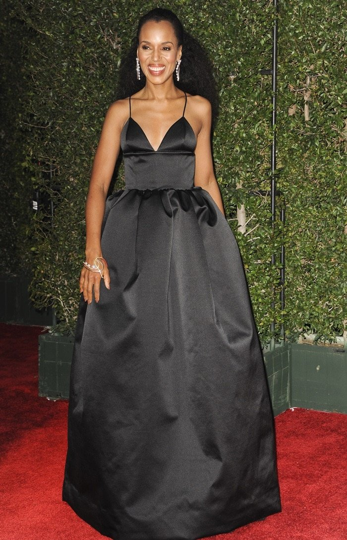 Kerry Washington showing some cleavage in a black satin Michael Kors Collection gown at the 2018 NAACP Image Awards at the Pasadena Civic Auditorium in Pasadena, California, on January 15, 2018