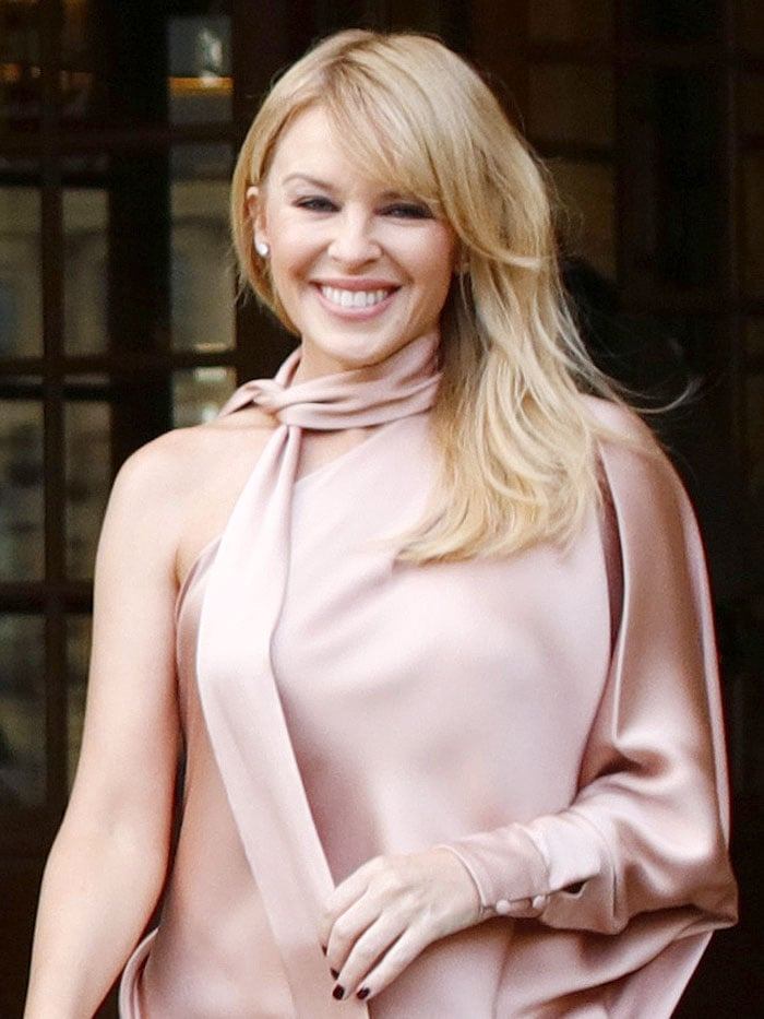 Kylie Minogue was spotted wearing her Ralph & Russo one-sleeved satin dress at the Ralph & Russo Spring/Summer 2018 Couture fashion show
